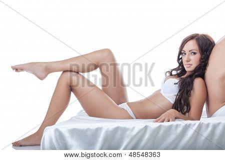 Sexy leggy brunette rests on back of partner