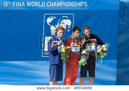 Jul 23 2009; Rome Italy; Troy Dumais (USA)  (left) Chong He (CHN)  (centre) and Alexandre Despatie (CAN) in the men's 3m springboard diving competition at the 13th Fina World Aquatics Championships
