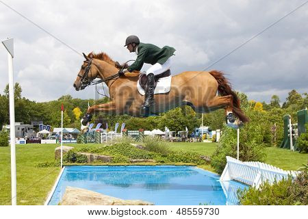 24/06/2011 HICKSTEAD ENGLAND, LOUGHNATOUSA W B ridden by Paul  Beecher (IRL) competing in the Bunn Leisure Derby trial at the British Jump Derby Equestrian meeting at Hickstead West Sussex England