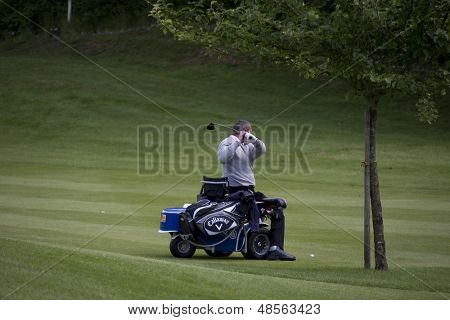 SAINT-OMER, FRANCE. 16-06-2010, A disabled golfer on a specially adapted cart at the European Tour Open de Saint-Omer, part of the Race to Dubai tournament and played at the AA Saint-Omer Golf Club