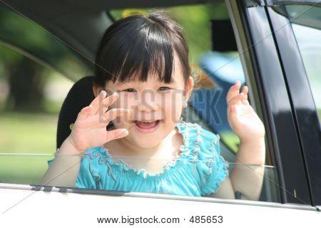 Girl Waving The Car.