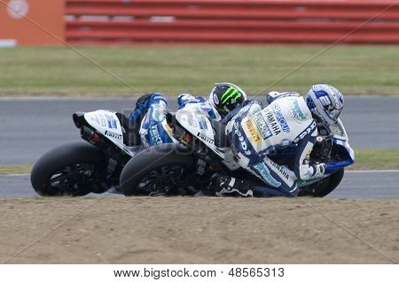 27 Sept 2009; Silverstone England: Rider number 2 Leon Camier (GBR) overtakes Rider number 7 James Ellison (GBR) on the inside  at the MCE Insurance British Superbike Championship