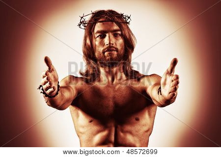 Jesus Christ reaches out to humanity.