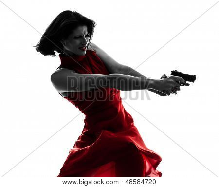 one sexy caucasian woman holding gun in silhouette studio isolated on white background