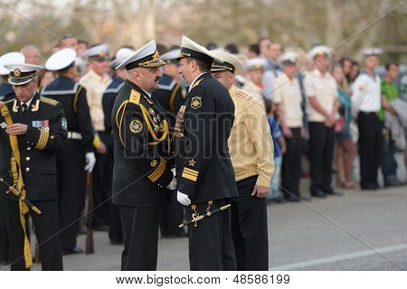 SEVASTOPOL, UKRAINE - MAY 7: Vice admirals Fedotenkov, Russia, right and Ilyin, Ukraine, handshakes on the rehearsal of military parade in honor of Victory Day in Sevastopol, Ukraine on May 7, 2013