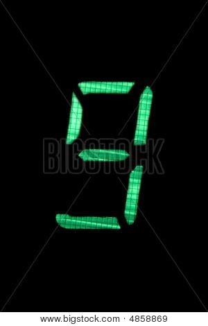Digital Number Nine In Green On Black Background