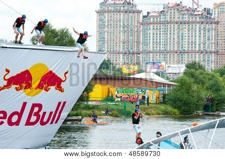 MOSCOW - JULY 28: Competitors jump to water on Red Bull Flugtag on July 28, 2013 in Moscow. Red Bull Flugtag is an event in which competitors attempt to fly homemade human-powered flying machines