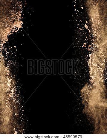 Isolated make-up powder on black background