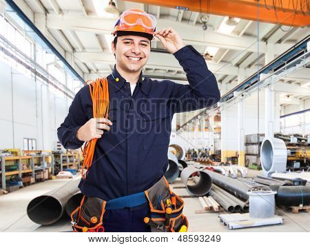 Portrait of an happy worker in a factory