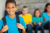 cheerful african american primary school boy with backpack poster