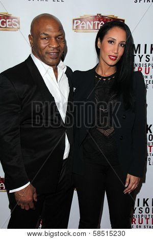 Mike Tyson, Kiki Tyson at the Opening of