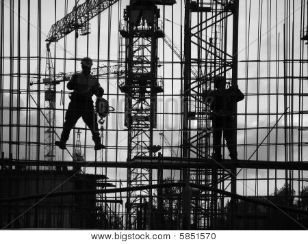 poster of construction site, evening, workers assemble the elements of the building structure.