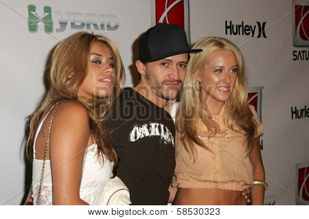 HOLLYWOOD - AUGUST 02: Clifton Collins Jr. and friends at Saturn's X-Games 12 Party at 6820 Hollywood Blvd on August 02, 2006 in Hollywood, CA.