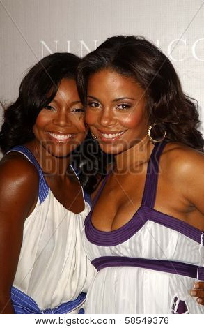 BEVERLY HILLS - APRIL 26: Gabrielle Union and Sanaa Lathan at the Nina Ricci Fashion Show and Gala Dinner to Benefit The Rape Foundation at Barneys New York on April 26, 2006 in Beverly Hills, CA.