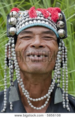 Portrait man from Asia Akha with traditional headdress poster