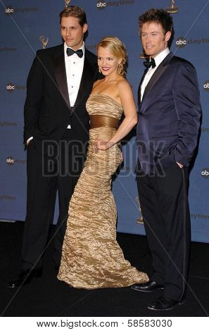 HOLLYWOOD - APRIL 28: Justin Bruening with Alexa Havins and Jacob Young in the press room at The 33rd Annual Daytime Emmy Awards at Kodak Theatre on April 28, 2006 in Hollywood, CA.