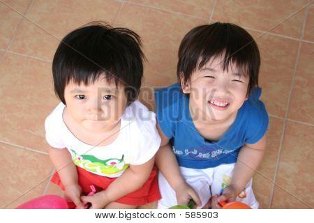 Girl & Boy Sitting