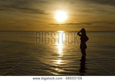 Sunrise And Traveler Sihouette