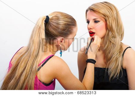 Make-up Artist Applying Mascara On Lips