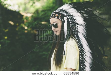 woman in a headdress on the nature background