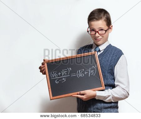 Schoolboy in glasses with mathematical equation