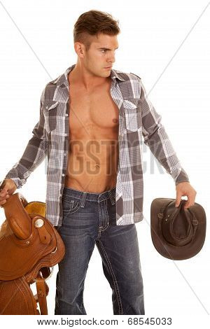 Man Plaid Shirt Hold Saddle And Hat Shirt Open