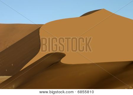 Orange Sand Dune With Wave Like Shadow
