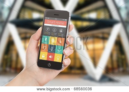 Female Hand Holding Black Smart Phone With Smart Home Application On The Screen