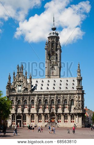 MIDDELBURG, THE NETHERLANDS - JULY 1, 2014; Unidentified people in front of the famous city hall of Middelburg on July 1 in Middelburg, Zeeland, The Netherlands,