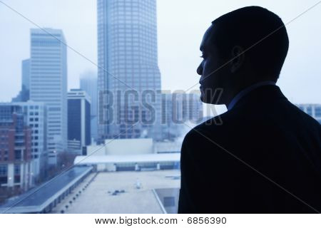 Businessman Looking Through A Window