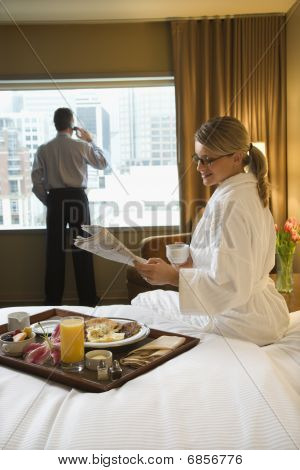 Woman And Man In Hotel Room