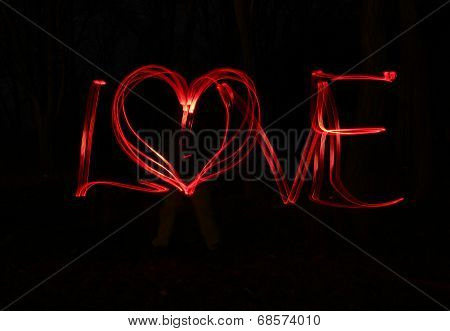 Love and heart - blur photo of red lamps