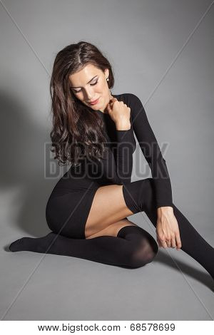 Portrait Of Brunette Beautiful Girl Posing In Black Dress