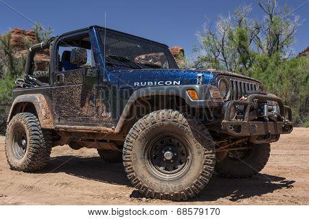 Muddy Jeep in Utah's Canyonlands