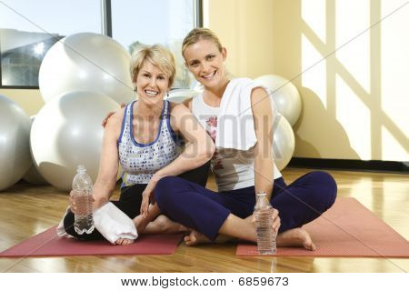 Women Sitting And Smiling At Gym