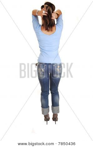 Young Woman Standing From Back.
