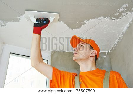 Plasterer at indoor ceiling renovation decoration with float and plaster poster