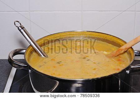 Bulk batch of fish soup in saucepan.