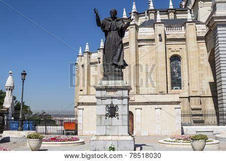 Statue Of Pope John Paul Ii Near Almudena Cathedral Dome In Madrid Spain