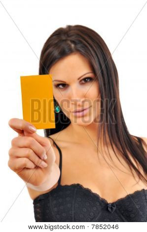 Sexy Young Woman showing yellow card
