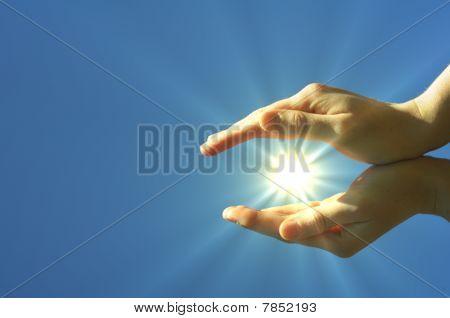 Hand Sun And Blue Sky