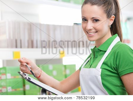 Supermarket Worker With Clipboard