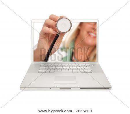 Female Doctor Holding Stethoscope Through Laptop Screen