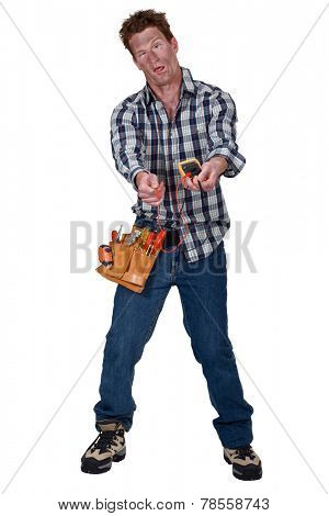 Disoriented man holding a multimeter