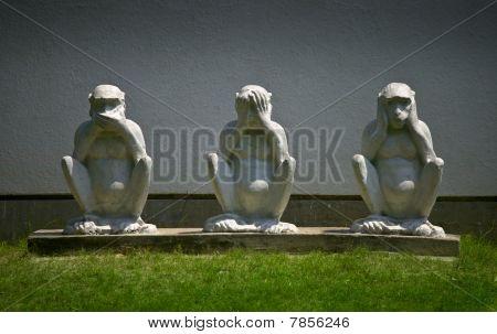 Statue of the three wise monkeys - speak no evil, see no evil, hear no evil. poster
