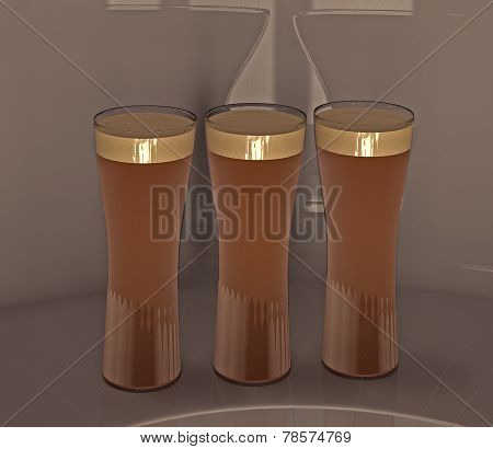 Three glasses of lager.