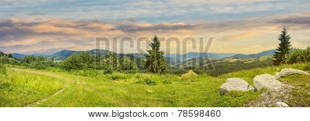 Boulders On Hillside Meadow In Mountain At Sunrise
