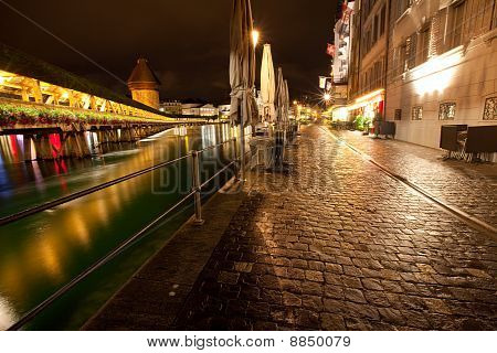 Night Time Scene Of European City Along River