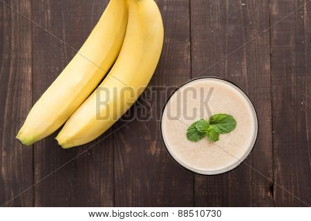 Top Shot Banana Smoothie On Wooden Table