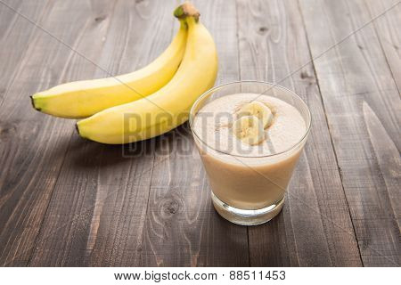Banana Smoothie On Wooden Table.